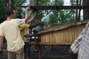 Finishing a coop build in the rain at Sophie's house in Sironko.